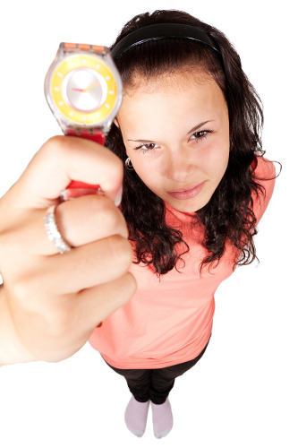 Picture of a woman pointing to her watch as if you were late. Typical management or customer reaction to delayed software projects